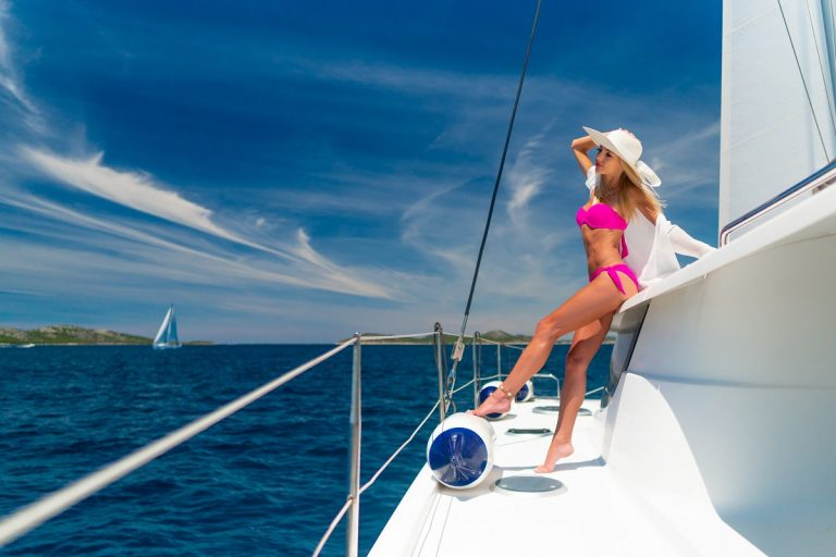 beautiful sexy woman in swimwear relaxing on a yacht at hot summer day in a cabo luxury charter yacht