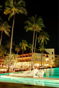 Green swimming pool and lying in night illumination in los cabos